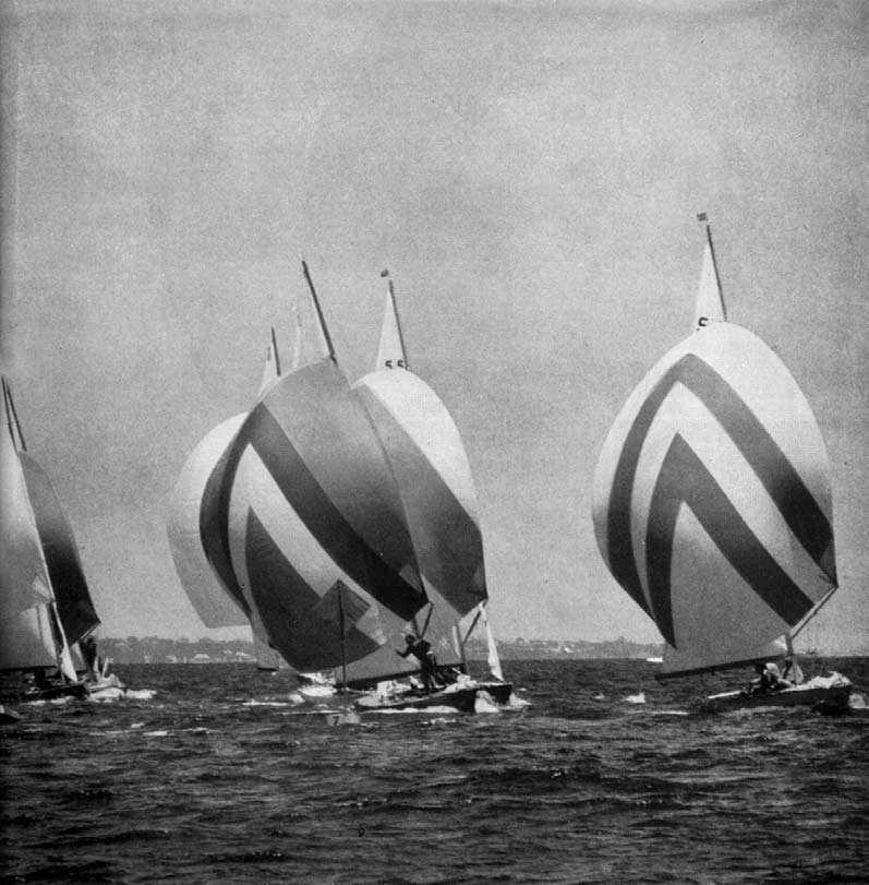 Almost together, seven. yachts near a buoy.