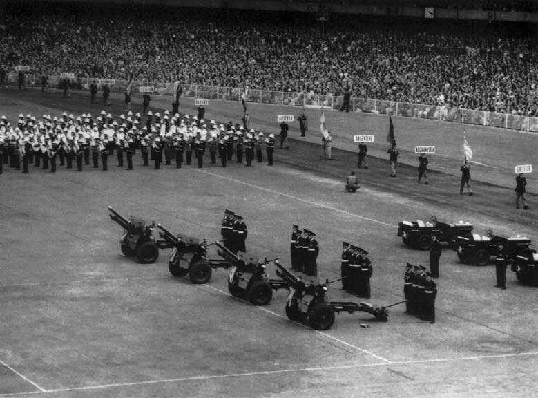 Three examples of Army co-operation. The saluting guns, the band and the name board bearers were all supplied by the n Military Forces. Naturally, the choir and band needed to be rehearsed.