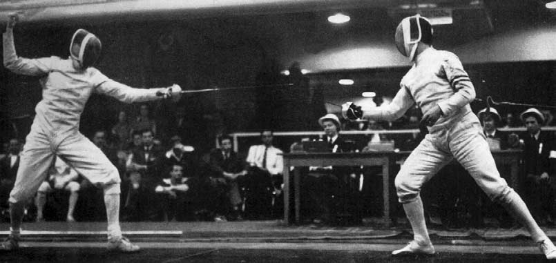 Pew (), left, and Pavesi (), during their epee bout. Pavesi won the Gold Medal and Pew was equal fourth...... 6. 7...... FIRST ROUND The first four in each Pool qualified for the Second Round.