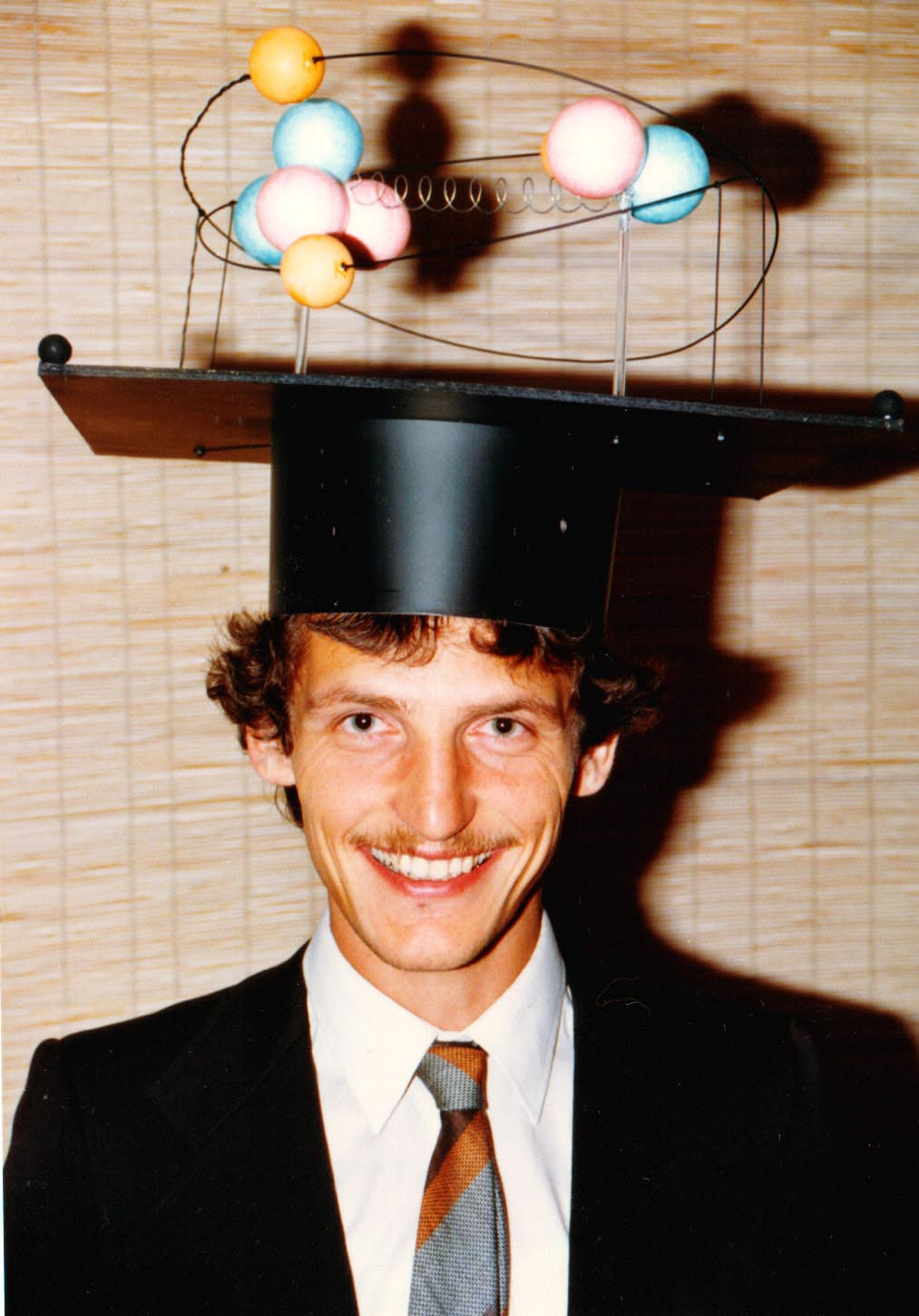 Such humorous mortar boards are a German academic tradition. on purely academic problems, and now wanted to gain experience with applied physics and how it connected with problems of the real world.