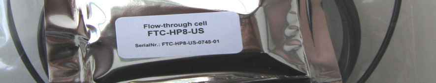 adapters to external tubing. Fig. 1 Flow-through cell ph 2.