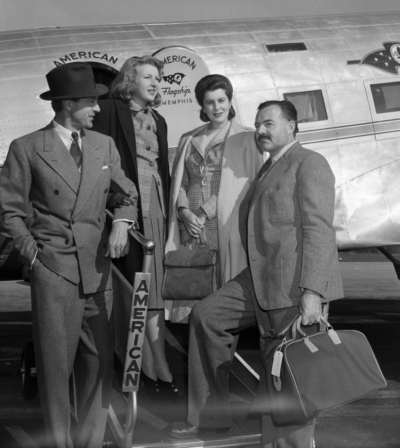 Hemingway (right) and Martha Gellhorn (second from the left) were met en route to China in January 1941 by film star Gary Cooper and his wife. Photo Bettmann/CORBIS.