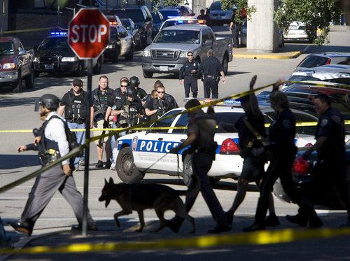 Part 2.2.2. Command Observations and Recommendations Figure 6 K-9 unit conducting campus search (photo by Larry Kolvoord, Austin American-Statesman) At approximately 12:20 p.m., unified command shrank the perimeter as buildings were searched and cleared of any suspects.