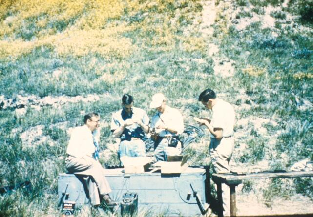 IN THE FIELD - BISMARCK BRIDGE LANDSLIDE (Left to right: Rockwell Smith, Ralph Peck, Herb Ireland, and Frank Bryant looking at samples of the Fort Union shale at the Bismarck Bridge landslide, circa