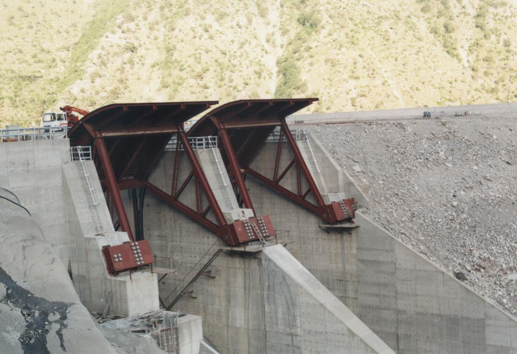 The Messochora HEP Spillway Type : open with gates, inclined channel, ski jump,