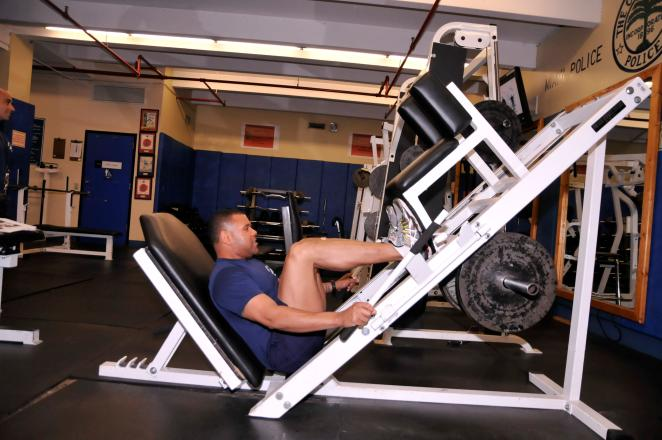 LEG PRESS TARGET AREA: UPPER LEG STRENGTH Plant feet flat and securely on base about 4 inches apart. Release safety stops and slowly lower the weight as you inhale.