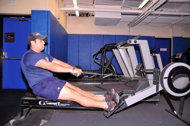 ROW TARGET AREAS: BACK AND BICEPS Sit on floor in front of pulley.