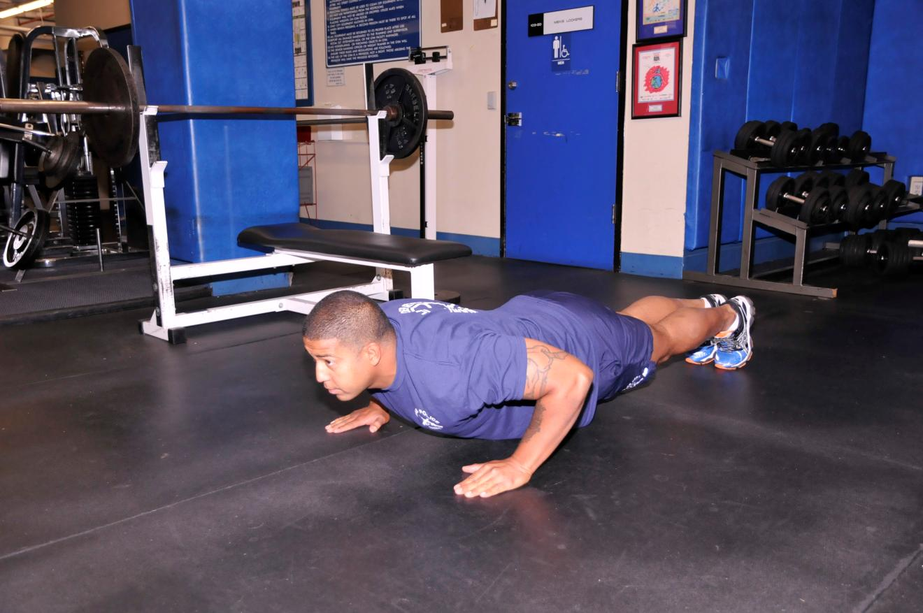 PUSH-UP TARGET AREAS: CHEST AND TRICEPS Lie on the ground face down with hands in front of you, palms down.