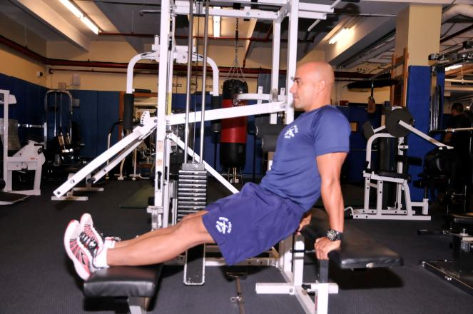 SEATED DIP TARGET AREA: TRICEPS Place palms behind you on one bench and rest feet on another bench.