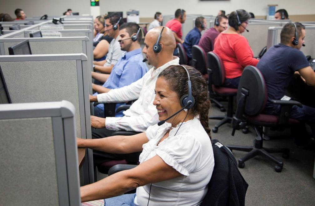 Step into this contact center and you are surrounded by sounds you would expect: the clicking of keyboards and the low hum of conversations conducted in perfect American English.