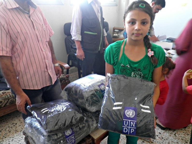 Homs, in addition to 126,250 pieces of of women, men and children clothing that were distributed in nine affected governorates; Aleppo, Al-Hassakeh, Deir-Ez-Zor, Hama, Homs, Idleb, Rural Damascus and