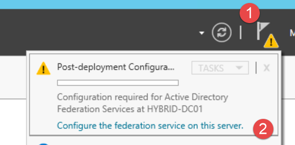 6. Configure Active Directory Federation Services a. On HYBRID-DC01, open the Server Manager and click the Task Details button (1).