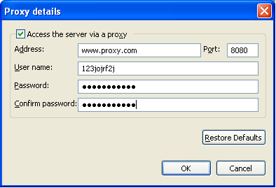 3. In the Proxy details dialog box, select Access the server via a proxy. Then type the proxy server address and port number.