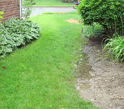 Grading Grading means creating a level base or specified slope to improve drainage around a building. One of the most common causes of water in basements is poor drainage.