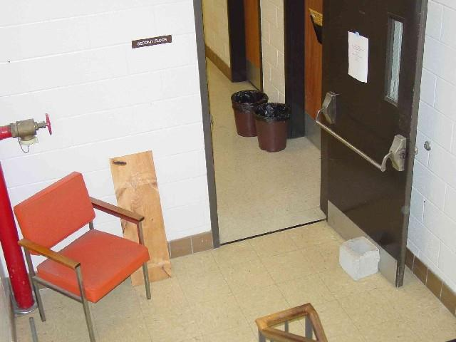 Place chairs in dangerous areas. For example, the chair in the picture could represent a struck against hazard.