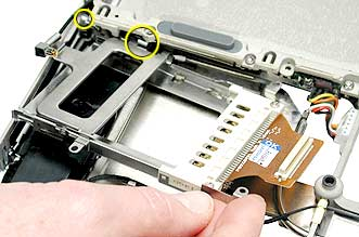 When installing the replacement PC card cage, ensure that the metal flange that is closest to the PC card eject button goes