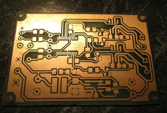 signals/copper) PCB is then immersed in etchant solution and