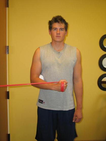 SHOULDER STRENGTHENING EXERCISES 6. Internal Rotation with Theraband Place Theraband in door. Squeeze shoulder blades together. Pull hand toward stomach. Slowly return to starting position. 7.