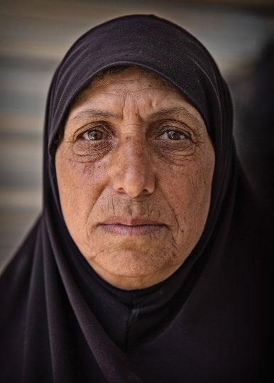 Bana, AGE 42, JORDAN Our neighbors had engaged their 13-year-old daughter and when I heard the news I went to speak with them.