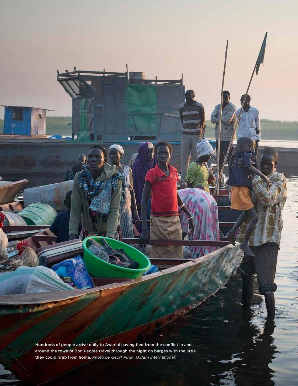 Bor. People travel through the night on barges with the little