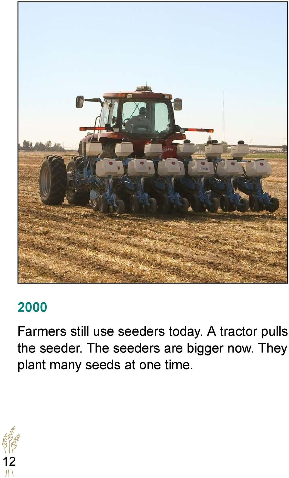 A tractor pulls the seeder.