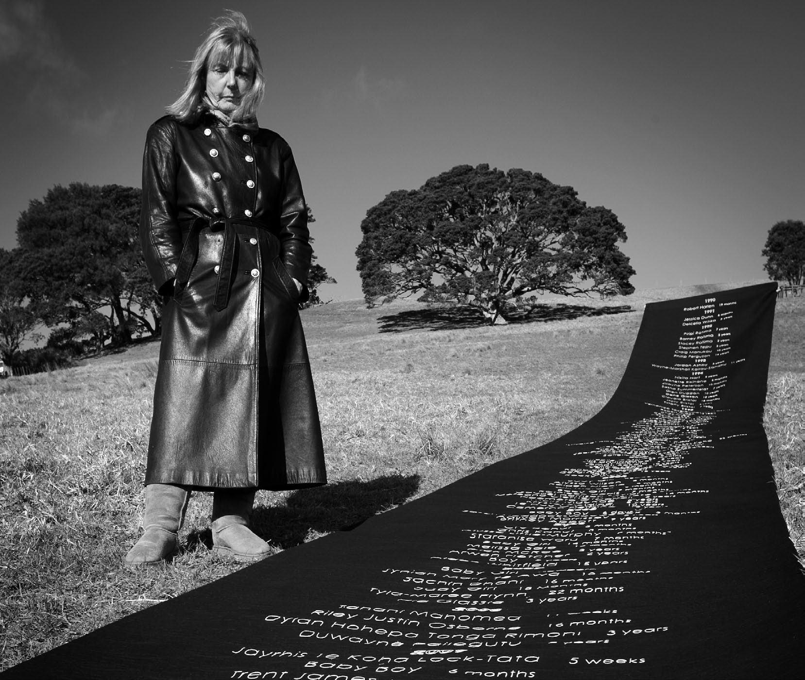 Thelma McGough with a 14-metre-long quilted memorial to the 139 children killed by child abuse in New Zealand