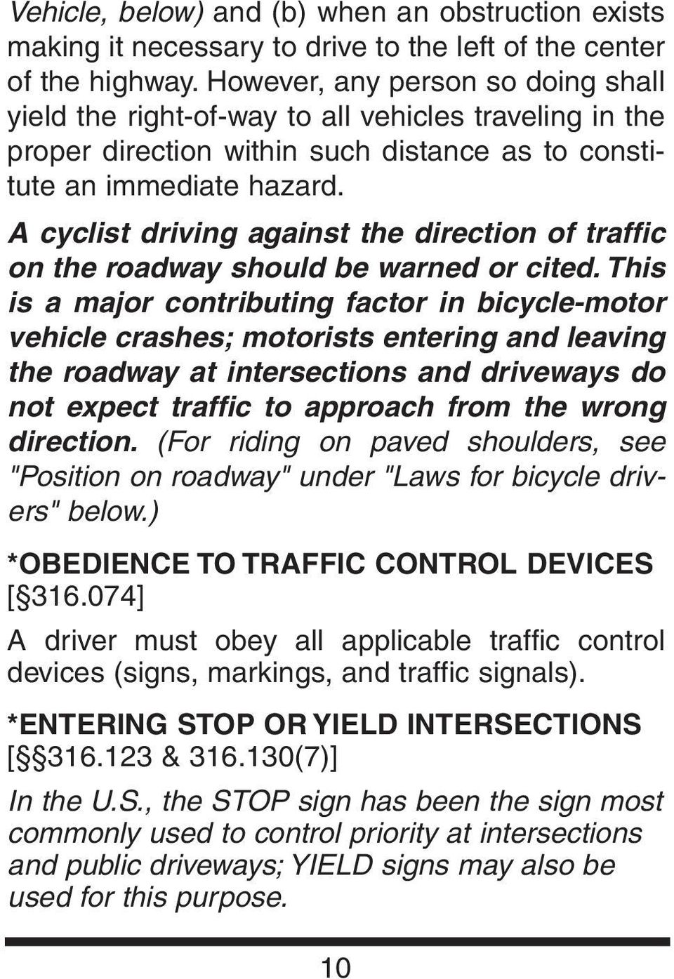 A cyclist driving against the direction of traffic on the roadway should be warned or cited.