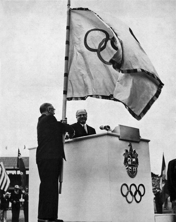 Mr. Brundage hands the Olympic flag to the Lord