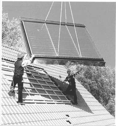 2009 - Higher The photograph shows a solar panel being installed. Water passing through the panel is heated by the sun.