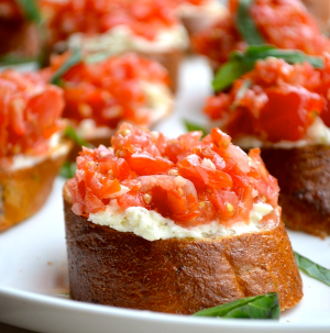 WHIPPED FETA CROSTINI Ingredients: make enough for 2 per person 6 ounces feta 2 ounces cream cheese, softened 4 tablespoons olive oil 1 lemon, juiced ½ onion 1 garlic clove, minced 2 tablespoons red