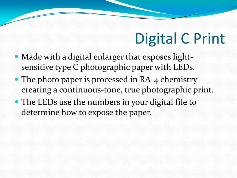 The photo paper is processed in RA-4 chemistry creating a