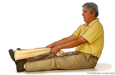 For the toe stretch exercise for the bottom of the foot: Sit in a chair, and extend your affected leg so that your heel is on the floor.