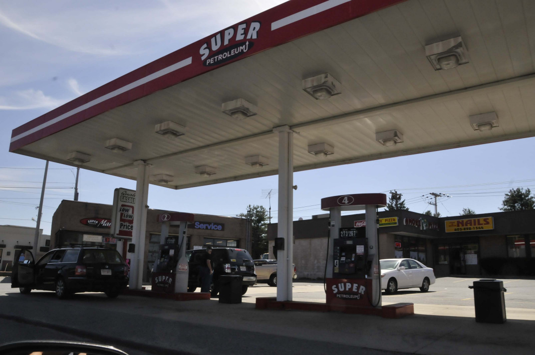 GAS STATION, CONVENIENCE STORES & DRIVE-THROUGH CANOPY LIGHTING Lit canopies, architectural features, or devices used to illuminate gas stations, convenience stores, and drive-through elements of a