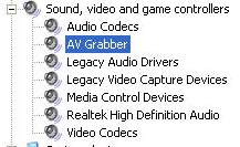 Click on the + (plus sign) in front of Sound, video and game controllers, AV Grabber should be displayed under this category.