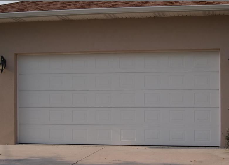 Section 9.36.2.7 of the BCBC requires garage vehicular doors to have an R Value of 6.245 or RSI 1.1 when conditioned.