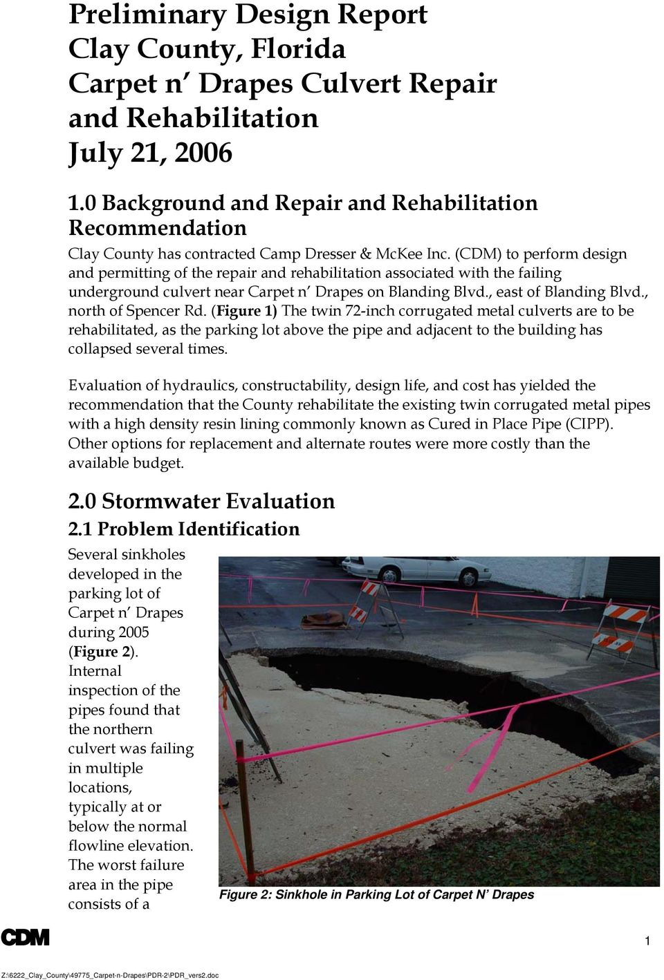 , north of Spencer Rd. (Figure 1) The twin 72-inch corrugated metal culverts are to be rehabilitated, as the parking lot above the pipe and adjacent to the building has collapsed several times.