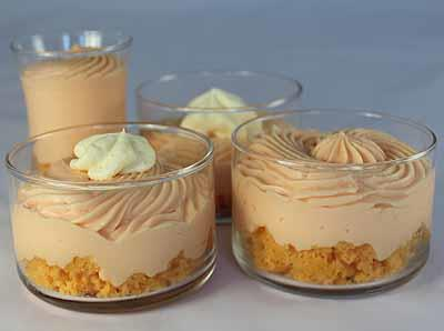Citrus Delight Cheesecake Crumble 1 package Orange Cream Chiffon Cheesecake Mix 3 cups 2% low-fat milk 1 Sunburst Orange Cake, prepared* 1 cup Whipped Topping, prepared (optional) *Left over pieces
