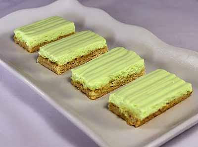 Key Lime Cheesecake Bars 1 package Vanilla Cookie Mix* 1 stick butter 1 egg 2 tablespoon water 1 package Key Lime Chiffon Cheesecake Mix* 3 cups 2% low-fat milk lime zest (optional) *You may