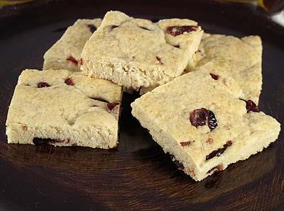 Lemon Cranberry Bars 1 package Lemon Cookie Mix 1 / 2 cup dried cranberries 1 stick of butter 1 egg 2 tablespoons water Recipe Yields: 24 bars or 6x4 cut 1.