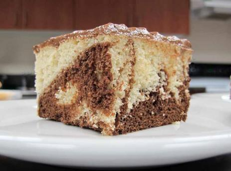 Marble Cake 1 package Vanilla Cake Mix* 1 package Chocolate Cake Mix* 3 cups warm water 1 package Chocolate Frosting* 1-1 / 3 cups 2% milk *Additional variations are possible by substituting