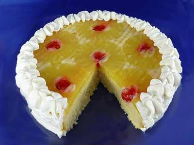 Pineapple Upside-Down Cake 1-20 ounce can sliced pineapple 1-8 ounce jar maraschino cherries 10 ounces (1/2 package) Vanilla Cake Mix 3/4 cup warm water 1 tablespoon Pineapple Gelatin Mix 2 cups