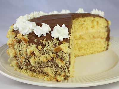 Boston Cream Pie 1 package Yellow Cake Mix 1-1/2 cups Egg Custard (prepared) 1 cup Chocolate Frosting (prepared) Recipe Yields: One layer cake or 20 slices 1.