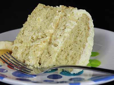 Caribbean Cruise Cake 1 package Banana Cake Mix 2 cups cold orange juice 1 package Whipped Topping Mix ½ cup shredded, unsweetened coconut ½ cup crushed, well-drained pineapple orange zest (optional)