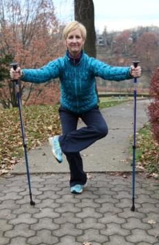 14 Urban Poling COOL-DOWN STRETCHES* 4. BACK THIGH STRETCH: With one foot elevated, reach your chest forward. 6.