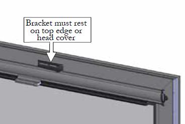 Rest the door closer bracket on top edge of the screen head cover, and position the end of the door closer bracket on the mark from step I. Mark the screw locations for the top door closer bracket.