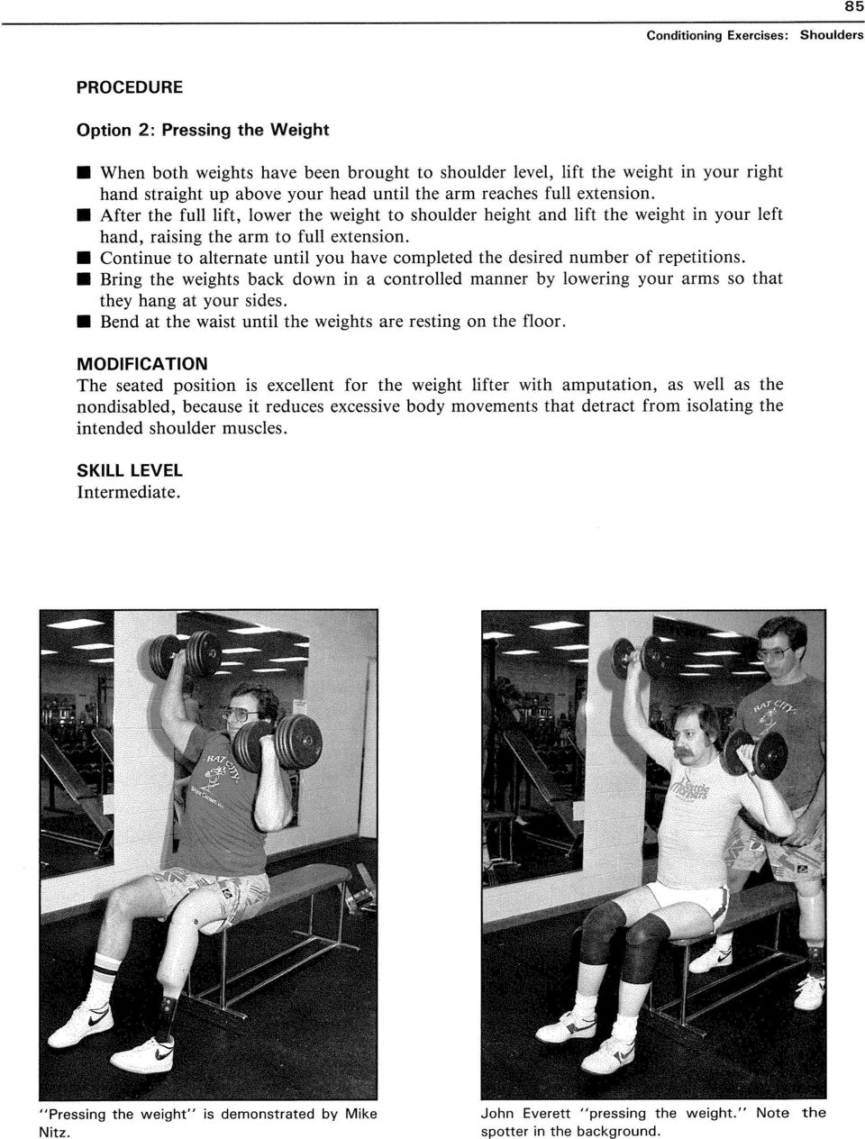 Continue to alternate until you have completed the desired number of repetitions. Bring the weights back down in a controlled manner by lowering your arms so that they hang at your sides.