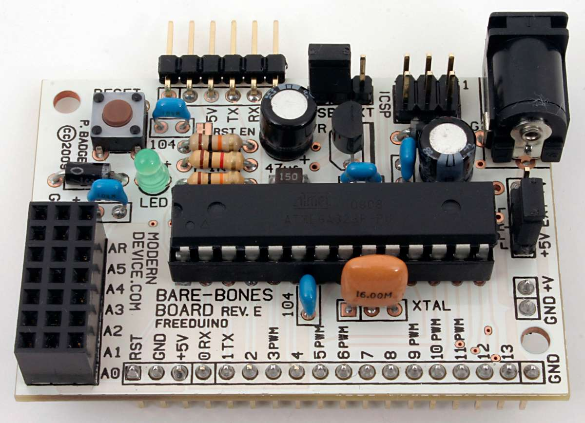 Bare Bones Board Arduino Compatible Assembly Instructions Rev E Capacitor A Sitting Crookedly On The Circuit Base 3 Module With Header Pins Set Up For Breadboard Use