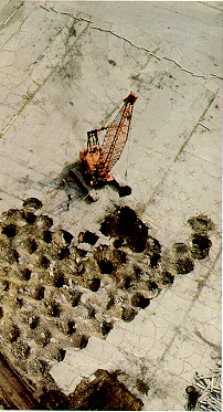Dynamic compaction Uses a special crane to lift 5-30 tons to heights of 40 to 100 feet then drop these