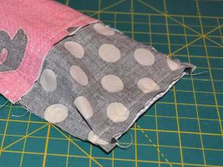 7. Constructing the Pincushion a. Cut the wool felt into a half circle by folding the 3 x 4 piece in half, forming a 3 x 2 rectangle and rounding the outside corners. b. Sew the felt half circle to the matching cotton scrap, using ¼ seam.