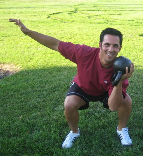 Squat Potato o Squat down holding the ball of the kettlebell in both close to your chest.